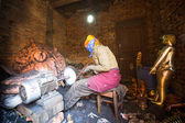 Nepalese tinmans working in the his workshop. — Stock Photo