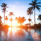 Sunset at a beach resort — Stock Photo