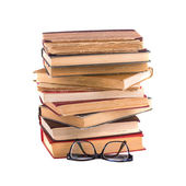 Stack of old books and spectacles — Stock Photo