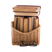 Stack of old antique books in basket — Stock Photo