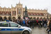 Unidentified participants during demonstration on Main Square in Krakow — ストック写真
