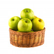 Fresh green apples in wooden basket — Stock Photo #41830417
