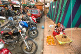 Woman seller in center of city — Stock Photo