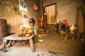 Nepalese child in the workshop — Stock Photo