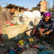 Постер, плакат: People from poorer areas working in sorting of plastic on the dump
