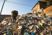 People from poorer areas working in sorting of plastic on the dump — Stock Photo