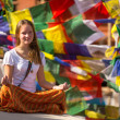 Girl sitting in the Lotus position on Buddhist stupa — Stock Photo