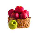 Red and green apples in a wooden basket — Foto de Stock