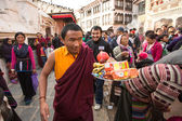 Buddhist pilgrims near stupa Boudhanath in Nepal — Stock Photo