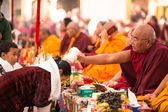 Buddhist monks near stupa Boudhanath in Nepal — Stock Photo