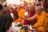 Buddhist monks near stupa Boudhanath in Nepal — Stock Photo