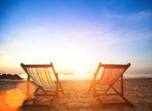 Chairs on sea coast — Stock Photo