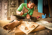 Nepalese man working in his workshop — Stock Photo