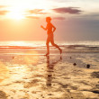 Young woman jogger at sunset — Stock Photo