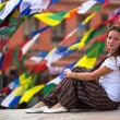Young girl sitting on Buddhist stupa — Stock Photo