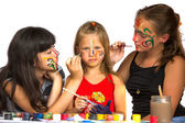 Two girl playing with painting with sister — Стоковое фото