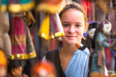 Young girl in a souvenir shop in Kathmandu. — Stock Photo