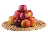 Fresh apples in a wicker baskets — Stock Photo