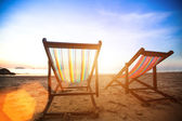 Pair of beach loungers on the deserted coast sea — Stock Photo