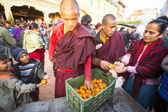 Unidentified Buddhist pilgrims near stupa Boudhanath — Stock Photo