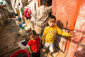 Unidentified local children near their homes in a poor area of the city — Stock Photo