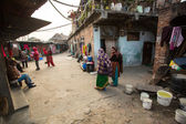 Unidentified local people near their homes in a poor area of the city — Foto Stock