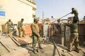 Nepalese police during a operation on demolition of residential slums — Stock Photo