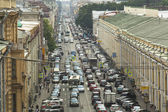 Cars stands in traffic jam on the city center — Stockfoto
