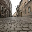 Cobble road, paving, in historical center of Krakow, old city — Stock Video #45052163