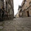 Cobble road, paving, in historical center of Krakow, old city — Stock Video #45052173