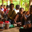 Постер, плакат: Unidentified people Orang Asli in his village