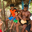 Постер, плакат: Unidentified children and men Orang Asli in village