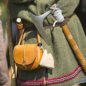 Clothing medieval reenactment, haversack and hatchet — Stock Photo