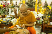 Unidentified monk makes traditional Yantra tattooing — Photo