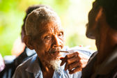 Unidentified old man Orang Asli in his village — Stock Photo