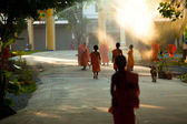 Unidentified children spend a monk at a Buddhist monastery Wat Klong Prao, — Stock Photo
