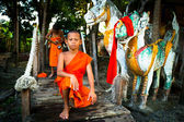 Unidentified child spend a monk at a Buddhist monastery Wat Klong Prao — Stock Photo