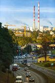Traffic in evening city — Stock Photo