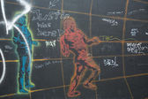 Fragment of graffiti on Berlin Wall at East Side Gallery — Stock Photo