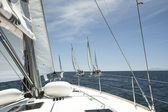 Unidentified sailboats participate in sailing regatta — ストック写真