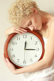 Young tender girl with big clock in hands — Stock Photo