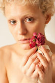 Sexy slim girl with dried rose in hands — Stock Photo