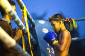 Unidentified young Muaythai fighter in ring during match — Stock fotografie