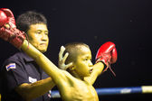 Unidentified young Muaythai fighter in ring during match — Stok fotoğraf