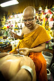 Unidentified monk makes traditional Yantra tattooing — Stock Photo