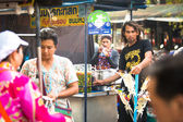 Unidentified beggar sells handicrafts near Ayutthaya Historical Park — Stock Photo