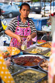 Unidentified street seller on market in the center about temples — Stock Photo