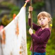 Sweet funny girl with the clothesline — Stock Photo
