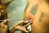 Unidentified monk makes traditional Yantra tattooing — Foto de Stock