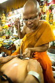 Unidentified monk makes traditional Yantra tattooing — Stok fotoğraf